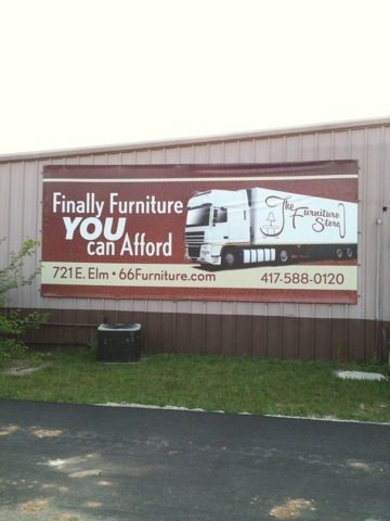 """A sign for a furniture store that says """"Finally furniture YOU can afford"""""""