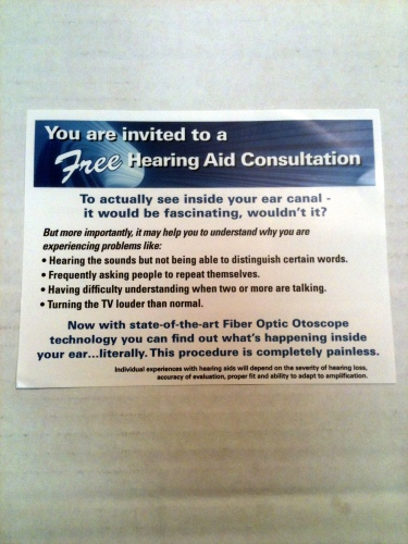 Photo of a card offering a free hearing aid consultation at Beltone