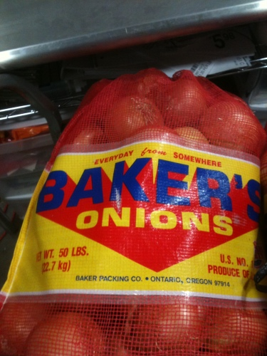 Photo of a large red bag of Baker's Onions with the tagline Everyday From Somewhere