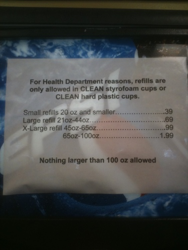 Photo of a sign listing the prices for refilling various sizes of cups with fountain pop at a gas station